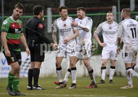 29/02/20. Sadlers Peaky Blinders Irish Cup Quarter final between Glentoran  and Crusaders at the Oval Belfast. Referee Andrew Davey  get surrounded by Crues players after a penalty award . Mandatory Credit - Inpho/Stephen Hamilton.