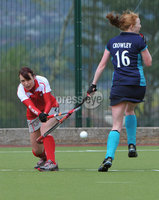 Mandatory Credit: Rowland White/Presseye. Women\'s Irish Hockey League. Teams: Pegasus (red) v Hermes (blue). Venue: The Dub. Date: 21st April 2012. Caption: Miriam Crowley jumps clear of a drive from Pamela Glass, Pegasus