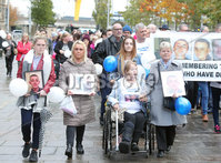 Press Eye Belfast - Northern Ireland 7th October 2017. Mental health march in Belfast city centre organised by campaigner Philip McTaggart, who lost his son Philip to suicide in 2003.  The march follows the death of 31-year-old Stephen Ferrin who died in September. He had previously lost his two brothers to suicide.  Stephen Ferrin\'s mother Patricia (second from front right. ) pictured at the march along with family and friends.. Picture by Jonathan Porter/PressEye.com.