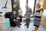 Press Eye - Belfast - Northern Ireland - 13th June 2018 - . The Prince of Wales has visited the Omagh Hospital and Community Care Complex in County Tyrone. His two-day visit to Northern Ireland began in Belfast earlier on Tuesday. The Omagh Hospital and Primary Care Complex opened to patients on 20 June 2017 and provides a range of hospital and community healthcare services together in one place. It ushered in a new era of joined up health care provision in the district.  It replaces the 118-year-old Tyrone County Hospital and investment in new equipment and technologies have improved patient care. The new hospital in Omagh has a 24-hour Urgent Care and Treatment Centre which provides cardiac assessment, a treatment room, x-ray and scans.. The Prince of Wales is pictured meeting patient John Black and Nurse Paulette Armstrong.. Photo by Kelvin Boyes / Press Eye..