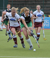 Mandatory Credit: Rowland White/Presseye. Women\'s Hockey: Irish Senior Cup Semi-Final. Teams: Queen\'s (blue) v Loreto (white). Venue: National Hockey Stadium, Dublin. Date: 12th May 2012. Caption: Claire Allison, Queen\'s and Hanna Matthews, Loreto
