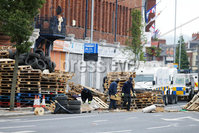 Press Eye - Belfast - Northern Ireland - 11th July  2018 . General view of the PSNI officers at the scene of the Cluan Place bonfire in east Belfast as contractors remove material from the 11th night bonfire.. A large police operation was also put in place with over 100 PSNI officers in riot gear present at the scene.. Photo by Kelvin Boyes / Press Eye..