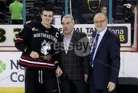Press Eye - Belfast, Northern Ireland - 30th November 2019 - Photo by William Cherry/Presseye. Robert Fitzpatrick, CEO Odyssey Trust and Eric Porter, Chairman Odyssey Trust presents Northeastern Huskies captain Ryan Shea with the prestigious Belpot trophy after Saturday evenings Friendship Four Championship game against Colgate Raiders at the SSE Arena, Belfast.      Photo by William Cherry/Presseye