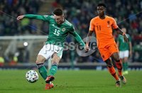 Press Eye - Belfast, Northern Ireland - 16th November 2019 - Photo by William Cherry/Presseye. Northern Ireland\'s Jordan Thompson with Netherlands\' Quincy Promes during Saturday nights UEFA Euro 2020 Qualifier at the National Stadium, Belfast.     Photo by William Cherry/Presseye
