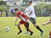 26th  July 2018. SuperCupNI 2018 Minor  section semi final between Greenisland and Portadown at Seahaven Portstewart.. Greenisland\'s Odhran McCart in action with Portadowns Johnny McCullough.  Mandatory Credit: Stephen Hamilton /Presseye
