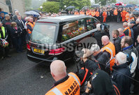 Press Eye - Belfast - Northern Ireland - 11th July 2018. Funeral for road racer William Dunlop at Garryduff Presbyterian Church outside Ballymoney in Co. Antrim.  The 32-year-old was killed while participating in the practise session of the Skerries 100 in Co. Dublin lat Saturday.  William\'s father Robert was also buried from Garryduff Presbyterian Church when he died at the North West 200 road race in 2008.. Willaim Dunlop\'s coffin arrives at the church for the funeral service. . Picture by Jonathan Porter/PressEye