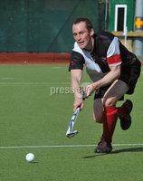 Mandatory Credit: Rowland White/Presseye. Men\'s Hockey: Irish Senior Cup Semi-Final. Teams: Cork Harlequins (black) v Instonians (yellow). Venue: National Hockey Stadium, Dublin. Date: 12th May 2012. Caption: Mark Black, Cork
