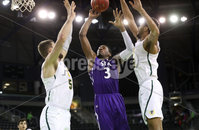 Press Eye - Belfast -  Northern Ireland - 30th November 2018 - Photo by William Cherry/Presseye. San Francisco\'s Jimbo Lull and Nate Renfro with Stephen F. Austin\'s Mitchell Seraille during Friday afternoons game in the Goliath bracket of the Basketball Hall of Fame Belfast Classic at the SSE Arena, Belfast.