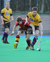Mandatory Credit: Rowland White/Presseye. Men\'s Hockey: Irish Hockey League. Teams: Banbridge (red) v Instonians (yellow). Venue: Banbridge. Date: 14th April 2012. Caption: Joshua Moffett, Banbridge and Julian Lewis, instonians