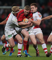 RaboDirect PRO 12, Thomond Park, Limerick 5/5/2012. Munster vs Ulster. Munster\'s Keith Earls is tackled by Nevin Spence and Paddy Jackson of Ulster. Mandatory Credit ©INPHO/Cathal Noonan