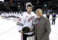 Press Eye - Belfast, Northern Ireland - 29th November 2019 - Photo by William Cherry/Presseye. Joe Bertagna, Hockey East Comissioner presents Northeastern Huskies Craig Pantano man of the game award after Friday afternoons Friendship Four game against New Hampshire Wildcats at the SSE Arena, Belfast. Photo by William Cherry/Presseye