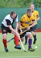 Mandatory Credit: Rowland White/Presseye. Men\'s Hockey: Irish Senior Cup Semi-Final. Teams: Cork Harlequins (black) v Instonians (yellow). Venue: National Hockey Stadium, Dublin. Date: 12th May 2012. Caption: Matthew Martin, Instonians and Paul Lombard, Cork
