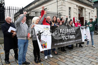 Press Eye - Historical Abuse Survivors - Court Of Appeal - 4th November 2019. Photograph by Declan Roughan. Margaret Mc Guckin SAVIA (Survivors & Victims of Institutional Abuse) and survivors raise their hands in victory outside the High Court In Belfast.. NI court of appeal rules civil servants can start compensation scheme for victims of historical abuse.. The court of appeal in Northern Ireland has ruled that the Executive Office has the power to bring forward a compensation scheme for victims of historical institutional abuse.. It follows a case brought by a survivor of historical abuse referred to in court as JR80 to see compensation payments made to victims in the absence of devolved ministers.. The ruling comes as Westminster considers legislation to introduce compensation payments before Parliament is dissolved on Tuesday ahead of the General Election..