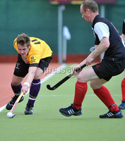 Mandatory Credit: Rowland White/Presseye. Men\'s Hockey: Irish Senior Cup Semi-Final. Teams: Cork Harlequins (black) v Instonians (yellow). Venue: National Hockey Stadium, Dublin. Date: 12th May 2012. Caption: Chris Kirk, Instonians and Jason Black, Cork