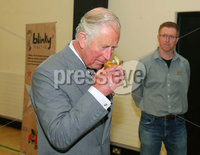 Press Eye - Belfast - Northern Ireland - 13th June 2018. As part of a two day visit to Northern Ireland Prince Charles and Camilla visited Owenkillew Community Centre, an established community facility based in the village of Gortin, Co Tyrone.  It opened in 1999 funded by Millennial Halls Grant and comprises a multi-use sports hall, meeting room, gym & playgroup with a Men's Shed being added in 2016.  It is set on a 7 acre site which also comprises a 55 bed hostel, 4 town houses, an outdoor Activity Centre, community garden, MUGA, footgolf course and is a key link for the village.. Prince Charles tries a drink from a local distillery.. . Picture by Jonathan Porter/PressEye