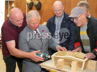 Press Eye - Belfast - Northern Ireland - 13th June 2018. As part of a two day visit to Northern Ireland Prince Charles and Camilla visited Owenkillew Community Centre, an established community facility based in the village of Gortin, Co Tyrone.  It opened in 1999 funded by Millennial Halls Grant and comprises a multi-use sports hall, meeting room, gym & playgroup with a Men's Shed being added in 2016.  It is set on a 7 acre site which also comprises a 55 bed hostel, 4 town houses, an outdoor Activity Centre, community garden, MUGA, footgolf course and is a key link for the village.. Prince Charles helps out in the Men Shed. . . Picture by Jonathan Porter/PressEye