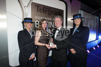 Press Eye - Belfast - Northern Ireland - Tuesday 24th April 2012 -  Picture by Kelvin Boyes / Press Eye.. 2012 Belfast Telegraph Northern Ireland Business Awards in association with bmi at the Ramada Hotel. MUST USE. Businessperson of the Year, sponsored by bmi. The judging panel chose Michael Ryan from Bombardier as Businessperson of the Year. Julie Jones, head of business sales, UK and Ireland, bmi, presented the trophy. . Also pictured are Nicola Wright and Claire Campbell from sponsors bmi..