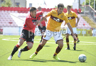 Press Eye - Belfast - Northern Ireland - 30th June 2018. Jordan Owens testimonial match between Crusaders and Motherwell at Seaview Belfast.. Crusaders Michael Carvill  in action with Motherwells Carl McHugh. Mandatory Credit: Presseye/Stephen Hamilton