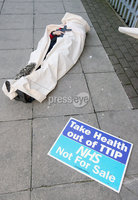 Press Eye - Belfast - Northern Ireland - 30th November 2018. Unite in the community holds a die-in protest at Capita assessment clinic on Linenhall Street in Belfast to highlight deaths from Universal Credit.  The protests coincide with a UK-wide mobilisation to demand the roll-out of Universal Credit is halted.. . Picture by Jonathan Porter/PressEye