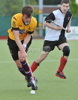 Mandatory Credit: Rowland White/Presseye. Men\'s Hockey: Irish Senior Cup Semi-Final. Teams: Cork Harlequins (black) v Instonians (yellow). Venue: National Hockey Stadium, Dublin. Date: 12th May 2012. Caption: Chris Kirk, Instonians