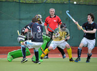 Mandatory Credit: Rowland White/Presseye. Men\'s Hockey: Irish Senior Cup Semi-Final. Teams: Lisnagarvey (blue) v Railway Union (yellow)). Venue: National Hockey Stadium, Dublin. Date: 12th May 2012. Caption: Andy Forrest on the ball for Lisnagarvey as Rail;way Union defend