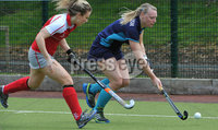 Mandatory Credit: Rowland White/Presseye. Women\'s Irish Hockey League. Teams: Pegasus (red) v Hermes (blue). Venue: The Dub. Date: 21st April 2012. Caption: Kerry McComish, Hermes and Kate McConnell, Pegasus