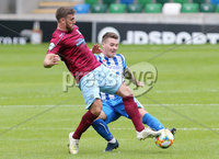 ress Eye - Belfast - Northern Ireland - 27th July 2020 - . Ballymena United FC v Coleraine FC Sadler\'s Peaky Blinder Irish Cup Semi Final at the National Football Stadium at Windsor Park.. Ballymenas Steven McCullough with Coleraines Joshua Carson. Photo by Jonathan Porter Press Eye.