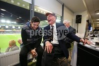 Press Eye - Belfast - Northern Ireland - 8th October 2016 - . The National Football Stadium at Windsor Park Opening Game and Ceremony. Northern Ireland vs San Marino 2018 FIFA World Cup Qualifier. Golfer Rory McIlroy shares a joke with NI Football legend Harry Gregg pictured at the National Football Stadium. Photo by Kelvin Boyes / Press Eye .