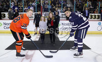 Press Eye - Belfast, Northern Ireland - 30th November 2019 - Photo by William Cherry/Presseye. Kathryn Hill from the Department for Communities performs the ceremonial faceoff with Princeton Tigers captain Derek Topatigh and UNH Wildcats captain Anthony Wyse during Saturday afternoons Friendship Four game at the SSE Arena, Belfast. Photo by William Cherry/Presseye