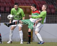 Press Eye - Belfast  - 11th August 2012. Danske Bank Premiership game between Glentoran and Donegal Celtic at The Oval, Belfast.. Glentorans John McGuigan and Donegal Celtics Ryan Deans with Conor Downey in action at Saturdays Danske Bank Premiership Game. . ©Russell Pritchard / Presseye