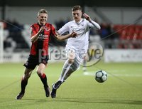 BetMcLean League Cup Third Round, Seaview, Belfast 9/10/2018. Crusaders FC v Ballinamallard United FC. Crusaders  Ross Holden    and  Ryan O\'Reilly   of Ballinamallard United. Mandatory Credit @INPHO/Brian Little .