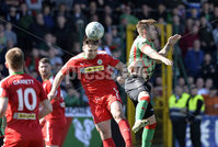 12th May 2018. Europa league play off final between Cliftonville and Glentoran at Solitude in Belfast.. Cliftonville\'s Jamie Harney  in action with Glentorans Robbie McDaid. Mandatory Credit: Inpho/Stephen Hamilton