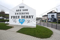 Press Eye - Belfast - Northern Ireland - 30th March 2020 - . General view of the famous wall mural at Free Derry corner in Derry which has been altered to pay tribute to the NHS.. Photo by Lorcan Doherty / Press Eye..