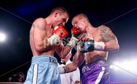 Picture -  Kevin Scott / Presseye. Belfast - Northern Ireland - Saturday 1st August 2015 - Feile Big Fight Night - (No Repro Fee) . Pictured is the fight between Alfredo Meil (Blue Shorts) vs Rhys Pagan (Purple Shorts) at the Feile big fight night in Belfast, Northern Ireland . . Picture - Kevin Scott / Presseye