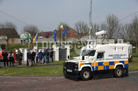 Press Eye - Belfast - Northern Ireland - 20th April 2019 -  . General view of a PSNI land-rover during an Easter Republican commemoration in the Kilwilkee Housing Estate, Lurgan, County Armagh organised by Republican Sinn Fein.. Photo by Kelvin Boyes  / Press Eye..