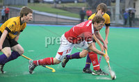 Mandatory Credit: Rowland White/Presseye. Hockey: Super 9\'s Finals. Teams: Cookstown Maverics (red) v Instonians Seahorses (yellow). Venue: Banbridge. Date: 25th April 2012. Caption: Raymond Millar, Cookstown