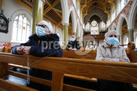 Press Eye - Belfast - Northern Ireland - 20th May 2020 -  . General view of parishioners at St Peters Cathedral in west Belfast pray under strict social distancing as churches in Northern Ireland have reopened today for individual prayer.. Photo by Kelvin Boyes / Press Eye..
