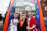 Press Eye - Belfast - Northern Ireland - 12th July 2019 - . Abbie Lowry, Fiona Lowry and Faith Ruberry at the Twelfth of July parade in Holywood, County Down.. Twelfth of July parades are taking place in 18 locations across Northern Ireland.. Tens of thousands of people are expected at the marches, which mark the anniversary of the Battle of the Boyne.. William III - the Dutch-born Protestant better known as William of Orange or King Billy - defeated the Catholic King James II in County Meath in July 1690.. Photo by Kelvin Boyes / Press Eye.