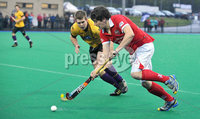 Mandatory Credit: Rowland White/Presseye. Hockey: Super 9\'s Finals. Teams: Cookstown Maverics (red) v Instonians Seahorses (yellow). Venue: Banbridge. Date: 25th April 2012. Caption: Mark Crooks, Maverics and William Robinson, Seahorses