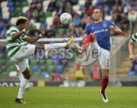 Press Eye - Belfast - Northern Ireland -14th July. Photo by Stephen Hamilton  / Press Eye.. Champions league qualifying match first leg between Linfield and Celtic at Windsor park in Belfast.. Linfields Andy Waterworth  in action with Celtics Scott Sinclair.
