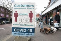 Press Eye - Belfast - Northern Ireland - 30th March 2020 - . General view of a Covid-19 customer sign in Botanic Avenue, Belfast, Northern Ireland requesting customers keep their distance.. Photo by Kelvin Boyes / Press Eye..