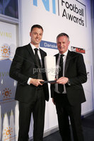 Press Eye - Belfast - Northern Ireland - 7th May 2018  - . NI Football Awards at the Crowne Plaza Hotel.. TRAVEL SOLUTIONS INTERNATIONAL PERSONALITY OF THE YEAR Michael O'Neill makes a presentation to Jonny Evans, International Personality of the Year . Photo by Kelvin Boyes / Press Eye .