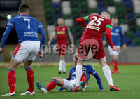 Press Eye - Belfast, Northern Ireland - 29th October 2019 - Photo by William Cherry/Presseye. Linfield\'s Kirk Millar with Cliftonville\'s Aaron Donnelly during Tuesday nights BetMcLean League Cup game at Windsor Park, Belfast.     Photo by William Cherry/Presseye