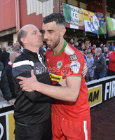 12th May 2018. Europa league play off final between Cliftonville and Glentoran at Solitude in Belfast.. Cliftonville\'s Joe Gormley is congratulated at the end of the game by manager Barry Gray. Mandatory Credit: Inpho/Stephen Hamilton