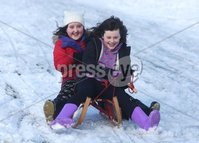 ©Lorcan Doherty February 12th 2018. . Beibhinn Magee and Hannah Kennedy enjoying the Mid Term Break snow fall in Brooke Park, Derry.