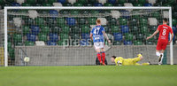 Danske Bank Premiership, Windsor Park, Belfast. 30/11/2019. Linfield FC  vs Larne FC. Linfield\'s      and       of Larne David McDaid shot rebounds of the inside of the post watched by Linfield goal keeper Rohan Ferguson. . Mandatory Credit  INPHO/Brian Little