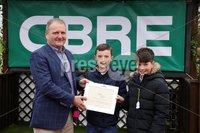 Press Eye - Belfast - Northern Ireland - 1st November 2019 - . Down Royal Racecourse - November Festival Day 1 - Friday . Race 1 - 12:40 CBRE PROPERTY EXPERTS MAIDEN HURDLE . Brian Lavery from CBRE makes a presentation to Matthew Love and Ted OLeary on behalf of the winning owners of  Fury Road.. Photo by Kelvin Boyes / Press Eye.. .