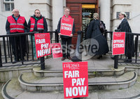 Press Eye - Belfast - Northern Ireland -  3rd October 2019. Civil servants pictured outside the Royal Courts of Justice in Belfast as union members stage a one day strike as part of ongoing action regarding pay. . Picture by Jonathan Porter  /   Press Eye.