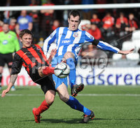 ©Press Eye Ltd Northern Ireland - 28th April 2012. Carling Premier league match betwen Crusaders and Coleraine at Seaview Belfast.. Crusaders Mathew Snoddy  in action with Coleraines David Ogilby.  Mandatory Credit - Picture by Stephen Hamilton /Presseye.com. .