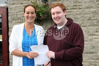 Mandatory Credit - Picture by Freddie Parkinson/Press Eye . Thursday 15 August 2019. Ballyclare High School. A Level Results on the increase once again in Ballyclare High School.. Dr Michelle Rainey Principal and Eoin Metcalfe who gained A* with 3A  and is going to QUB to study Chemistry